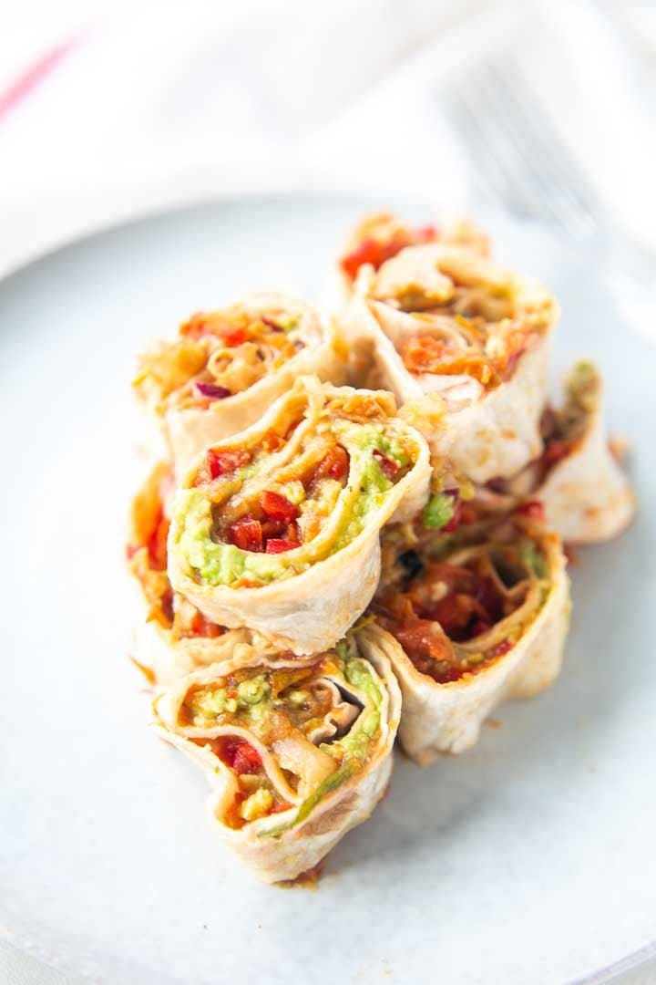 Mexican pinwheel roll-ups are the perfect party snack or appetizer roll-ups. If you want to know how to make a pinwheel take a look at this recipe. Visit thetortillachannel.com #thetortillachannel #pinwheels #roll-ups #appetizers #mexicanpinwheels