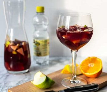 How to make sangria with this authentic sangria recipe. Only 7 ingredients and done in no time. Visit thetortillachannel.com for the full recipe. #thetortillachannel #sangria #sangriarecipe #authenticsangria #drinkrecipe