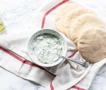 Greek authentic cucumber yoghurt dip sauce. This easy tzatziki is fresh and sharp dip sauce. Visit thetortillachannel.com #thetortillachannel #tzatziki #Greekdipsauce #cucumberyoghurtsauce #greektzatziki