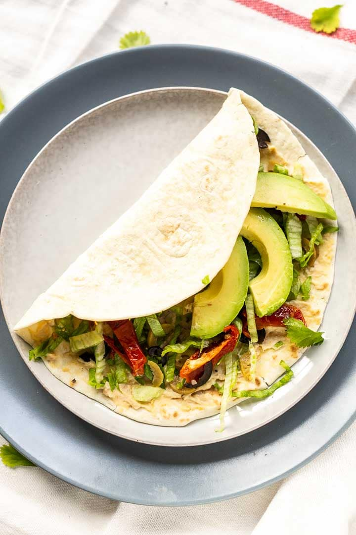How to make a tasty vegan wrap? This recipe contains delicious ingredients with a bite for a great lunch or dinner wrap. Super easy to make and done in no time. Visit the tortillachannel.com for the full recipe and instructions. #thetortillachannel #easywrap #tortillas #lunchrecipe #easydinnerrecipe #easydinner #veganwrap #vegantortilla