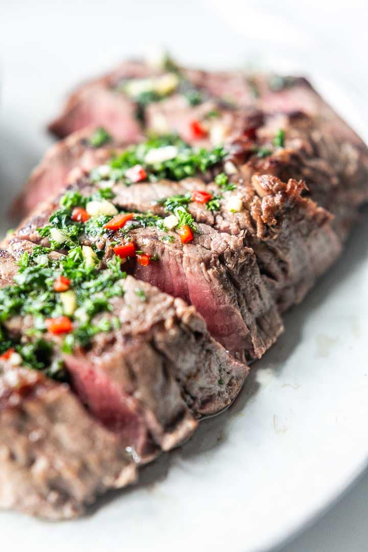 Looking for the best chimichurri steak recipe? Take a look at this delicious dinner recipe. Made with homemade chimichurri and grilled to perfection. Visit thetortillachannel.com for the full recipe #thetortillachannel #chimichurri #chimichurristeak #steakrecipe #dinner #dinnerrecipe