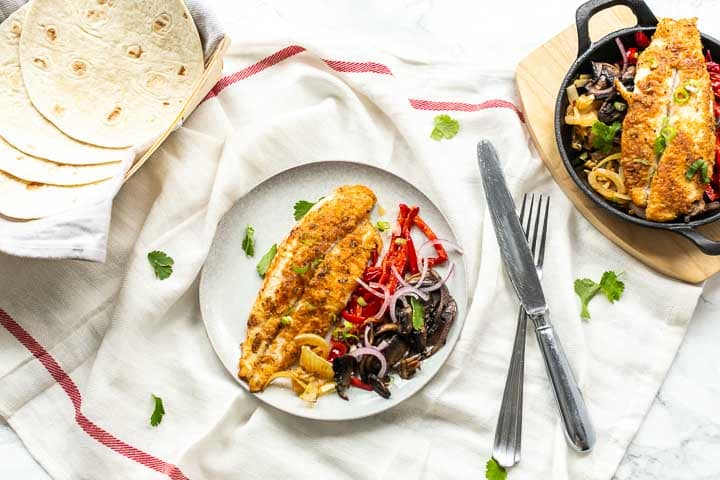 Looking for the best fish fajitas recipe? Take a look at this Panga filet fajitas. Super easy to make, perfectly seasoned with homemade fajitas seasoning and so tasty. Visit thetortillachannel.com for the full recipe #thetortillachannel #fishfajitas #pangafilet #fajitasrecipe #dinnerrecipe