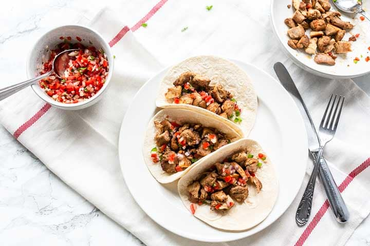 The easy chicken tacos are the best you ever tried! This dinner recipe is great for meal prep, taco tuesday or family dinner. Visit thetortillachannel.com for the full recipe. #thetortillachannel #tacorecipe #easychickentaco #chickentaco