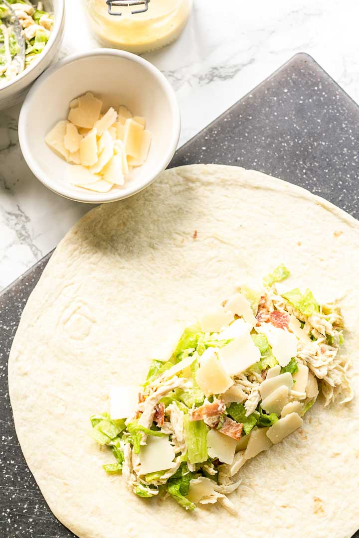Chicken caesar wrap is a great lunch or dinner recipe. Made with the best homemade caesar dressing. Visit thetortillachannel.com for the full recipe #thetortillachannel #wrap #chickenwrap #chickencaesarwrap