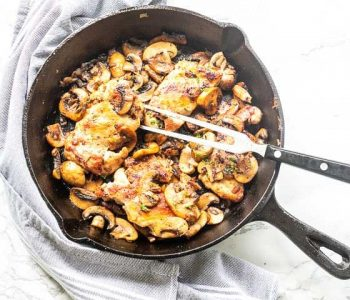 The best garlic chicken thighs with mushrooms is one of the best chicken recipes you ever tried. Made in a skillet, seasoned and pan fried. Visit thetortillachannel.com for the full recipe. #thetortillachannel #chickenrecipe #garlicchickenthighs #chickendinner #dinnerrecipe #easychicken #tastychicken