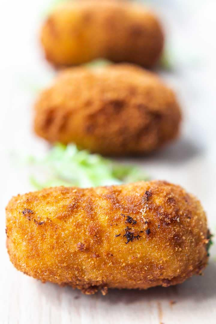 These Spanish croquettes with Serrano ham are the perfect tapas. Eat as a snack and serve with lemon mayonnaise. Visit thetortillachannel.com for the full recipe. #thetortillachannel #spanishcroquettes #croquettes #hamcroquettes #croquetas #croquetasjamonserrrano