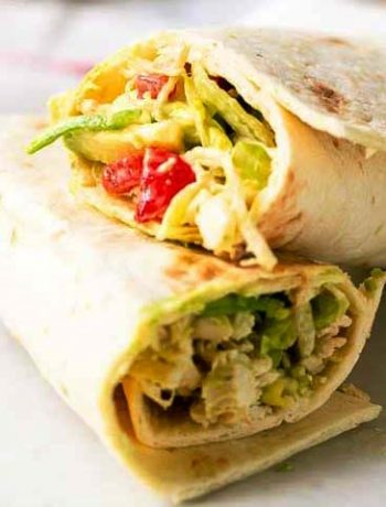 How to make a tasty chicken salad wrap. This lunch recipe or dinner dish is done in no time and made with shredded chicken en iceberg lettuce. Delicious with flour tortillas. Visit thetortillachannel.com for the full recipe #thetortillachannel #wraps #chickensalad #chickensaladwrap #lunchrecipe #dinnerrecipe