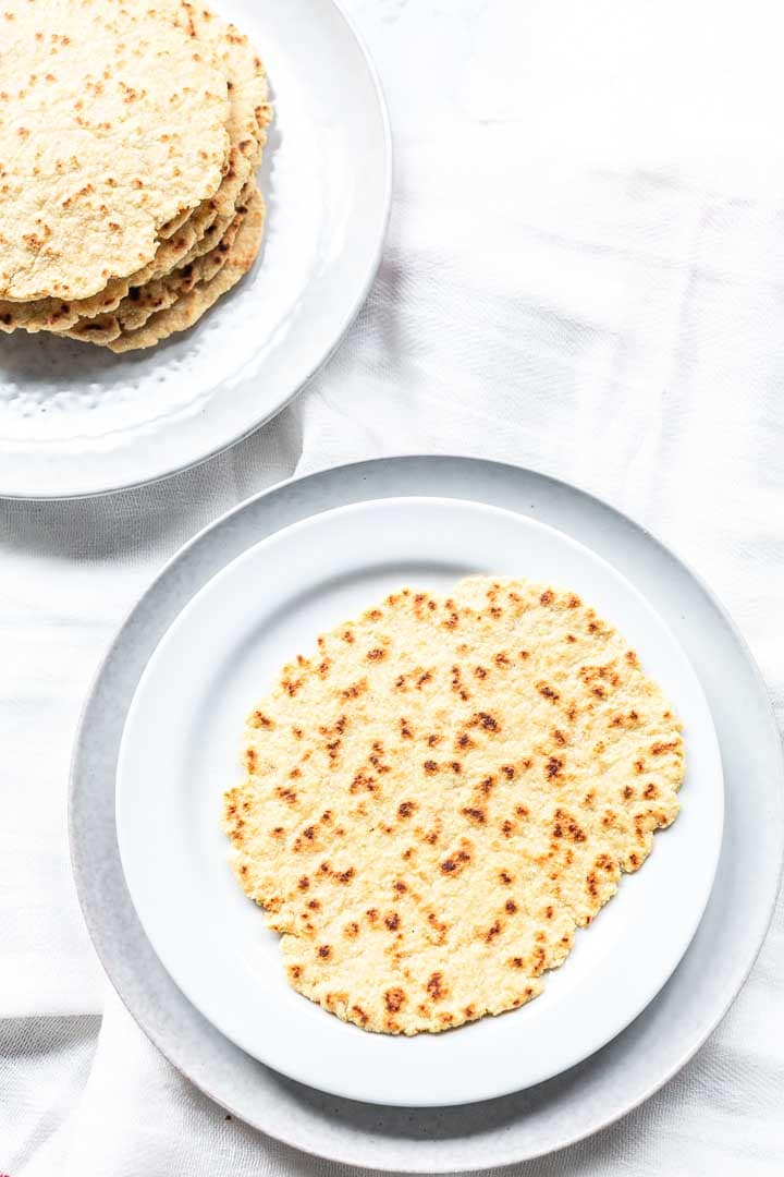 How to make the best keto tortillas recipe. Made with almond flour these tortillas are low-carb and gluten-free. They are pliable and so tasty. Visit thetortillachannel.com for the full recipe #thetortillachannel #ketotortillasrecipe #ketotortilla #lowcarbtortillas #almondflourtortillas