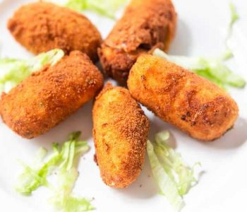 Do you love shrimp? Take a look at these fancy shrimp croquettes tapas or croquetas de camarones. Great as a snack, for a party or to eat as tapas. Visit thetortillachannel.com for the full recipe. #thetortillachannel #croquettes #shrimpcroquette #croquetas #croquetasdecamarones #tapas
