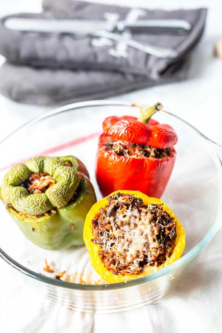 These Mexican stuffed peppers can be made in the oven or the crockpot. Season with delicious homemade taco seasoning and top with parmsan cheese. Visit thetortillachannel.com for the full recipe. #thetortillachannel #stuffedpeppers #mexicanstuffedpeppers #dinnerrecipe #crockpotrecipe #ovenbaked