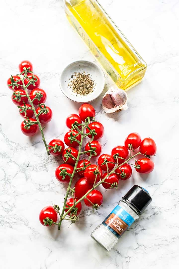 How to make sun-dried tomatoes in the oven. Take a look at this recipe. Delicious tomatoes that go great in your salads, in a wrap in soup or on a pizza. Visit thetortillachannel.com for the full recipe #thetortillachannel #romatomatoes #sun-driedtomatoes #tomatoes #driedtomatoes