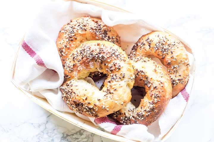 Easy homemade bagels are the best. No proofing, no cooking in boiling water, fluffy on the inside, crunchy and chewy on the outside. These bagels are perfect. Try this bagel recipe and visit thetortillachannel.com for the full recipe. #easybagels #bagelrecipe #2ingredientbagel #homemadebagel #lunchrecipe