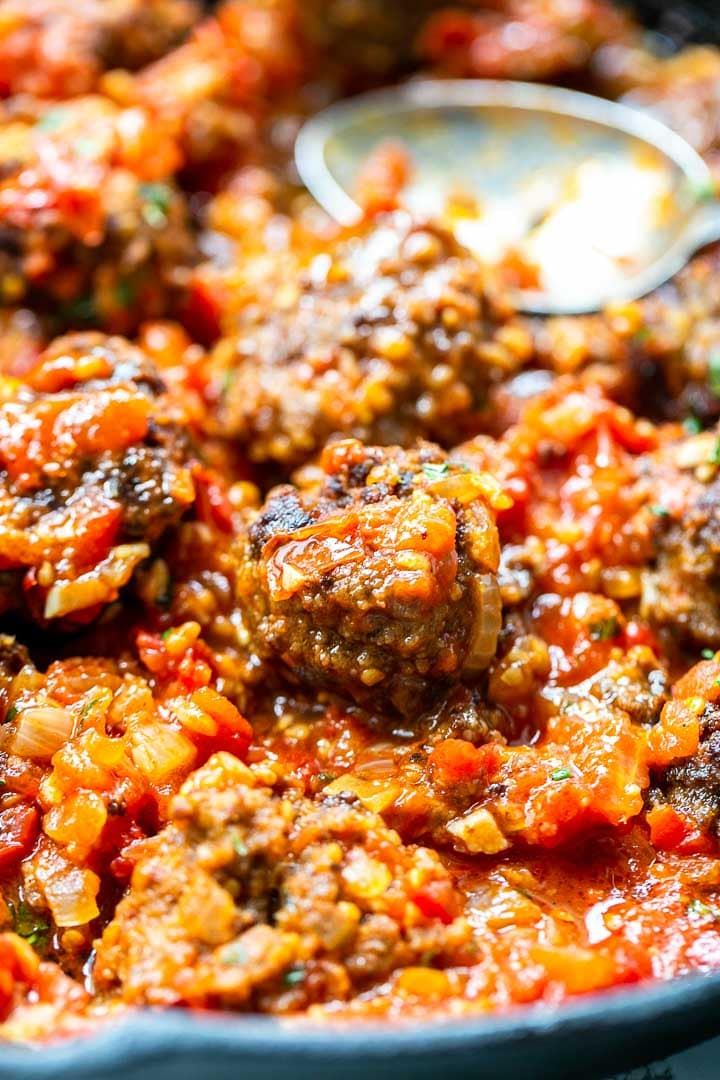 How to make albondigas Spanish meatballs that are a great tapas recipe. Smothered in a rich garlic tomato sauce. Visit thetortillachannel.com for the full recipe #thetortillachannel #albondigas #spanishmeatballs #meatballs #tapas