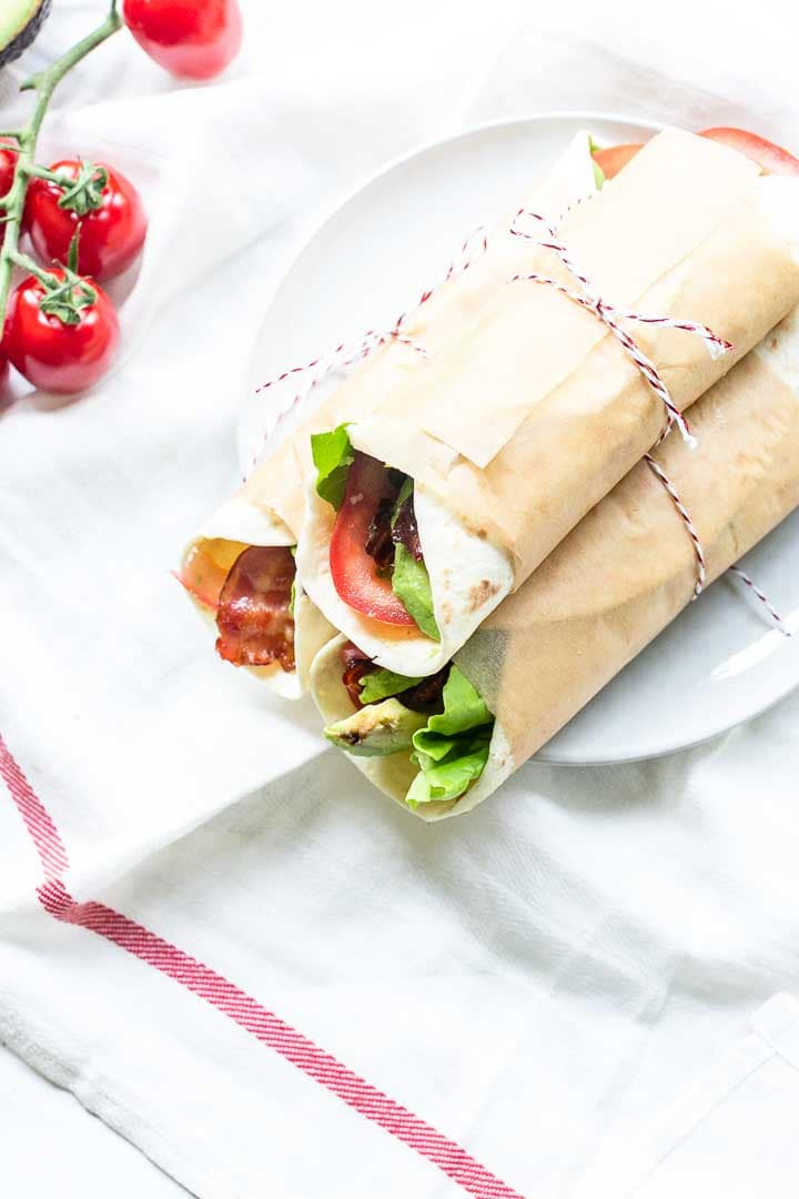 How to make the perfect lunch or dinner wrap. This classic BLT wrap is fast, simple and super tasty. Make your BLT with a tortilla for a tasty twist. Visit thetortillachannel.com for the full recipe #thetortillachannel #BLT #BLTwrap #lunchwrap #dinnerwrap #baconlettucetomato