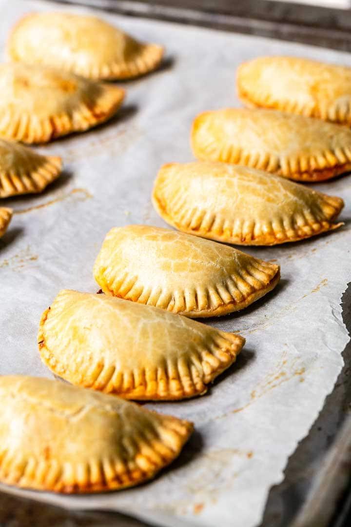 Empanadillas de bonita are Spanish empanadas filled with tuna. A Spanish tapas recipe that you can eat for lunch or before dinner. Visit thetortillachannel.com for the full recipe #thetortillachannel #empanadillas #empanadillasdebonita #spanishempanadas #empanadas #tapas #snack