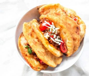 How to make Mexican chalupas for dinner with ground beef and vegetables. A great crossover between tostadas and tacos. Visit thetortillachannel.com for the full recipe. #thetortillachannel #mexicanchalupas #chalupas #chalupasdinner #dinner #dinnerrecipe
