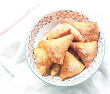 Looking for tasty sopapillas? Try this fried pastry coated with cinnamon sugar or drizzled in honey. A great dessert or sweet snack. Visit thetortillachannel.com for the full recipe #thetortillachannel #sopapillas #sopaipilla #friedpastry #dessert