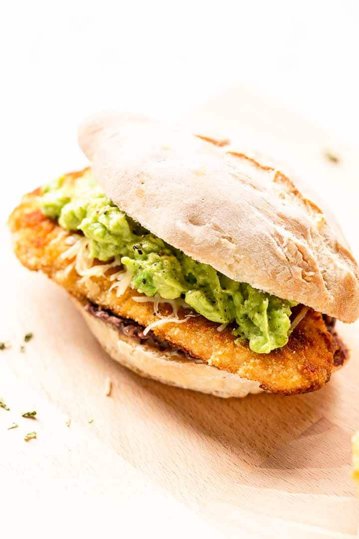 Looking for a delicious torta sandwich? Try this Mexican torta or torta Milanesa as this sandwich is made with a chicken schnitzel and lots more. Visit thetortillachannel.com for the full recipe #tortas #tortarecipe #tortasandwich #tortaMexicana #tortaMilanesa