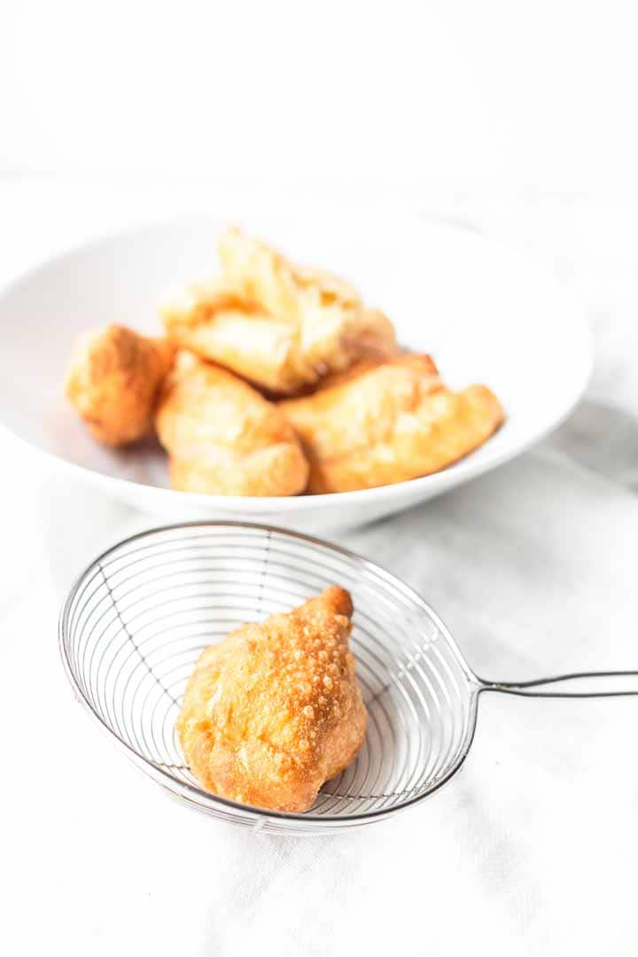 The best fried empanadas? Try these fried cheese empanadas. These are easy to make with your favorite cheese, sealed and fried. A great afternoon snack. Visit thetortillachannel.com for the full recipe #thetortillachannel #empanada #cheeseempanada #friedcheeseempanadas #friedempanada #friedempanadarecipe