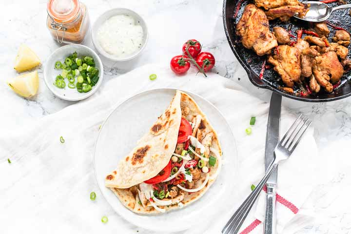 This is the best chicken shawarma wrap served with homemade gyro bread. A tasty wrap filled with chicken shawarma. Try it! Visit thetortillachannel.com for the full recipe #thetortillachannel #chickeshawarmawrap #chickenwrap #chickenshawarma