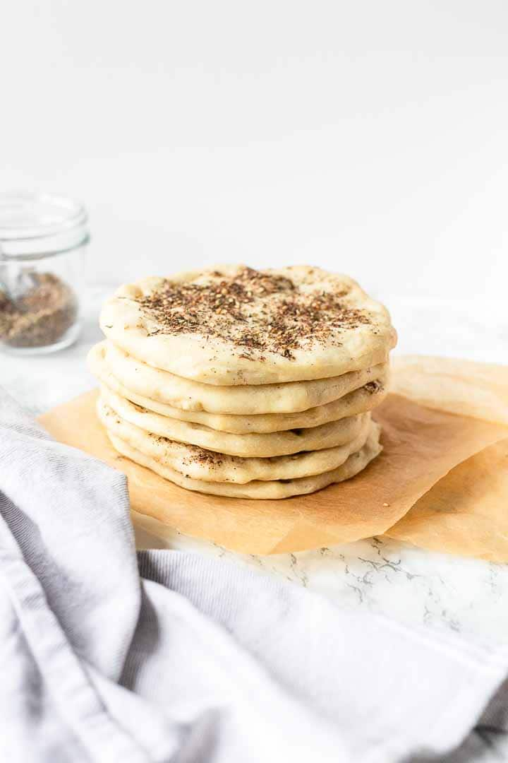 Manaeesh Lebanese flatbread is a great Middle Eastern flatbread recipe. It is like a Middle Eastern pizza recipe. Decorate with cheese, ground beef or za'atar seasoning. Visit thetortillachannel.com for the full recipe #thetortillachannel #manaeeshflatbread #lebaneseflatbread #flatbread