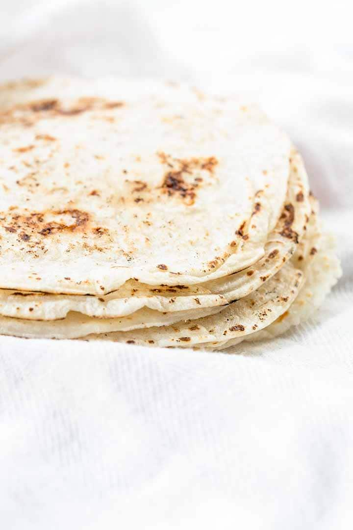The best gluten-free tortillas are rice flour tortillas. Just as soft and pliable as flour tortillas. Add your favorite fillings you will love it! Visit thetortillachannel.com for the full recipe #thetortillachannel #ricetortillas #glutenfreetortillas #tortillas