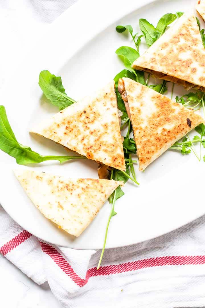 These mushroom quesadillas are amazing and are on the table in no time. This vegetarian dish is great to serve for lunch, brunch or dinner. Use your favorite mushrooms and flour tortillas. Fold it like an enchilada and cut in triangles. Want to try? Visit thetortillachannel.com for the full recipe #thetortillachannel #mushroomquesadillas #quesadillas #vegetarianquesadillas #easyquesadillas #lunch #dinner